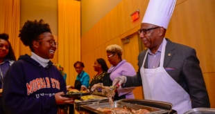 President Wilson serving thanksgiving food to student