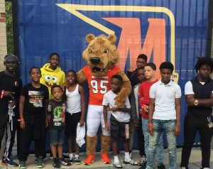 Local youth are treated to a Morgan State Bears football for their participation in the bike riding program