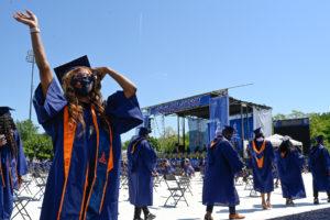 morgan graduate waving