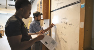 students at a whiteboard