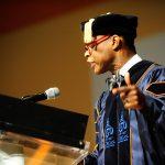 Graduate speaking at the podium