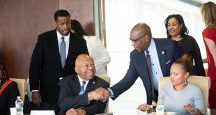 President Wilson shaking hands with Congressman Elijah Cummings