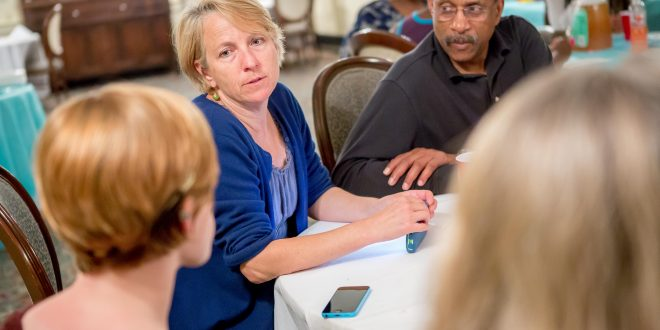 Prof. Karen Houppert and consultant Ron Taylor conferring with WVU colleagues