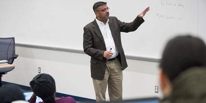 teacher teaching at a whiteboard