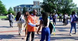 President Wilson shaking hands with student on the academic quad