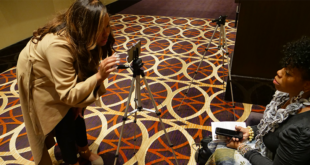 female interviewing with a phone
