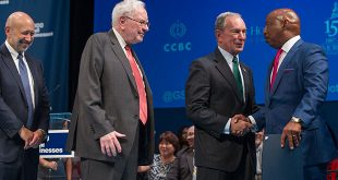 photo of Goldman CEO, Warren Buffett, and Michael Bloomberg congratulating one of the program graduates