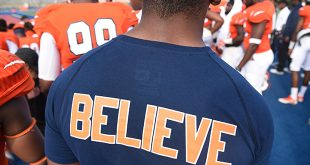 photo of student wearing a t-shirt that says believe